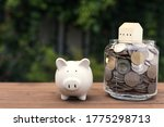 Piggy Bank And House Model On...