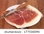 prosciutto with knife on white... | Shutterstock . vector #177530090