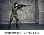 Soldier aiming the target with gun in building