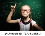 genius girl in red glasses near ... | Shutterstock . vector #177535550