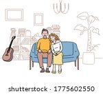 a couple is sitting on the... | Shutterstock .eps vector #1775602550