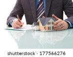 Man Signs Purchase Agreement...