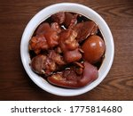 Small photo of Braised pig's trotters, eggs with brown soya sauce, rice wine and black vinegar. Traditional Chinese food.