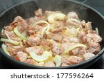 Fried Meat With Onion In A...