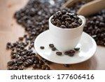 coffee beans in a coffee mug | Shutterstock . vector #177606416