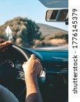 man driving car holds steering wheel - stock photo
