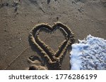 Heart Being Washed Away At The...