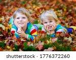 Two Little Twin Kids Boys Lyin...