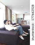 couple watching tv in the... | Shutterstock . vector #177662528