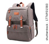 Small photo of Heather Brown Retro Vintage Canvas Nylon Diaper Bag Backpack Isolated. Satchel Rucksack with Leather Trim. Camping Daypack Front View. Travel Back Pack with Shoulder Straps & Haul Loop