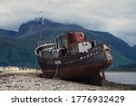 An Old Ship Washed Ashore On...