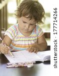 cute child girl studying  doing ... | Shutterstock . vector #177714266