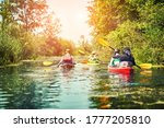 Group Of Young People On Kayak...