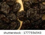 Dried Prunes In A Ceramic Bowl...