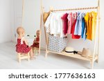 Dressing Closet With Clothes...