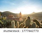 Small photo of View of San Pedro hill at sunrise in San Luis Potosi, old town like Real de Catorce, Mexico (Cerro de San Pedro pueblo magico)