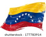 flag of  Venezuela in the wind with a texture - stock vector