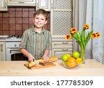 Smiling Boy Cutting A Slice Of...