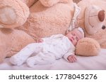 Little girl sleeping and hugging her teddy bear. New family and baby protection concept. My best friend baby sleeping with her teddy bear. - stock photo