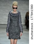 Small photo of NEW YORK, NY - FEBRUARY 10: A model walks the runway at the Katya Leonovich fashion show during Mercedes-Benz Fashion Week Fall 2014 at Lincoln Center on February 10, 2014 in New York City.
