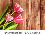 Pink Tulips On A Wooden...