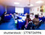 Small photo of Blurry image of business people in meeting room for shareholders' meeting or seminar event with projector, Annual shareholder meeting.