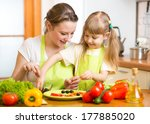 mother and kid daughter cooking ... | Shutterstock . vector #177885020
