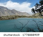 Scenic holy Dhumba Lake in Mustang,Nepal. Pristine, beautiful, calm, relaxing place. Visit Dhumba lake. Natural beauty of the lake. Clear water lake situated at the base of Mount Nilgiri, Jomsom trek. - stock photo