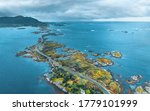 Aerial view Atlantic ocean road in Norway travel drone landscape stormy sky nature moody weather scandinavian landmarks destinations from above  - stock photo