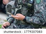 South Korean Army Soldier Using Smartphone