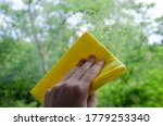 Male Hand And Yellow Rag. A Ma...
