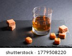 Glass Of Amber Whiskey With...