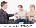 estate agent giving house key... | Shutterstock . vector #177963623