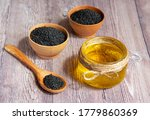 Glass Jar Of Sesame Oil And Raw ...