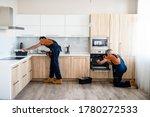Two Handymen  Workers In...