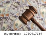 Small photo of Judges gavel and the money. Dollars and justice. Corrupt court. Trial of money scammers