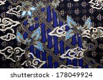 fabric with floral batik pattern | Shutterstock . vector #178049924