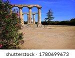 Temple of Hera at Metaponto, Basilicata, Italy with oleander in bloom and female tourist in white dress. Ancient Greek monuments of Magna Grecia are well preserved in Southern Italy