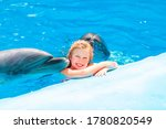 Happy Little Girl Swimming With ...