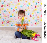 beautiful boy with tulips   Shutterstock . vector #178087670