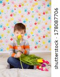beautiful boy with tulips | Shutterstock . vector #178087706