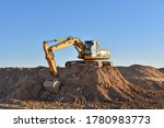 Excavator Working On...