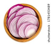 Small photo of Cross sections of red onions in wooden bowl. Slices of the onion cultivar Allium cepa with purplish red skin and white flesh tinged with red. Closeup from above, over white, isolated macro food photo.