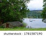 An Old Slate Boathouse On Lake...