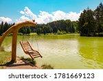Small photo of Bloke lake - Blosko jezero in the morning, wooden swing, volcje jezero, Nova Vas, Slovenia