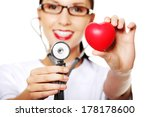 female doctor holding red heart