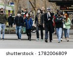 Small photo of Melbourne, Victoria, Australia - July 23rd 2020: People don masks en masse on the first day of Victoria's mask rule. Crossing the street in the CBD, everyone in sight is now wearing a mask.