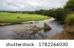 Erosion Of A River Bank On The...