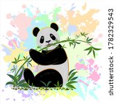 The Panda Sits On The Grass And ...