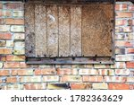 Boarded Up Window In Abandoned...